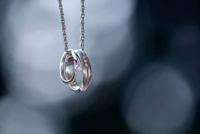 Two silver rings on a chain