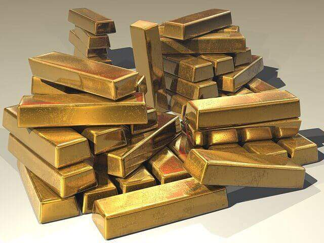 Precious metals for jewelry gold bullion bars stacked in a pile.
