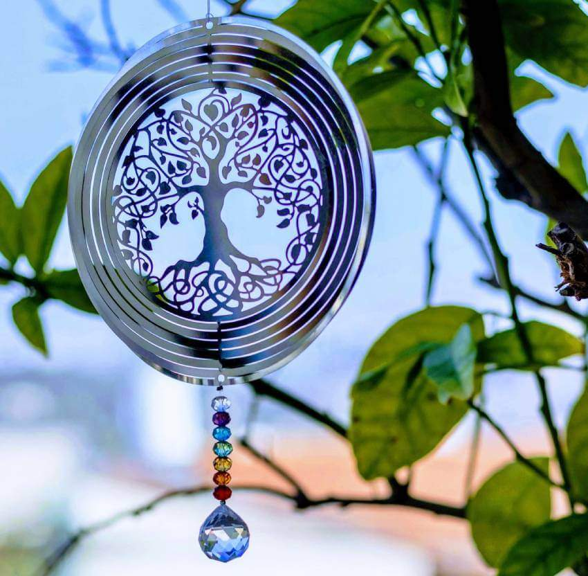 A Hindu tree of life and string of gemstones used in Vedic astrology