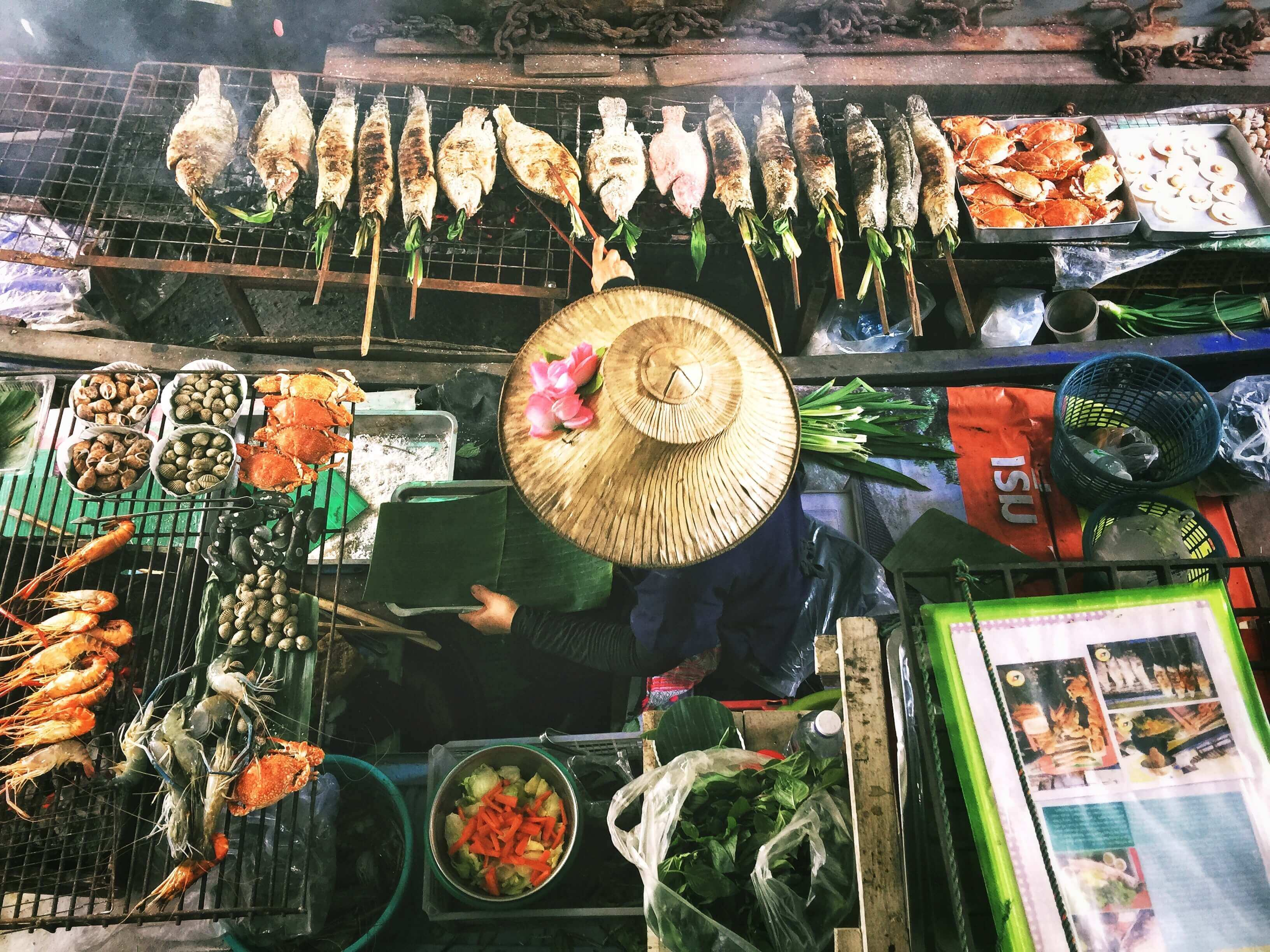 The bird's eye view of a Bangkok cook surrounded by grilled fish and seafood.
