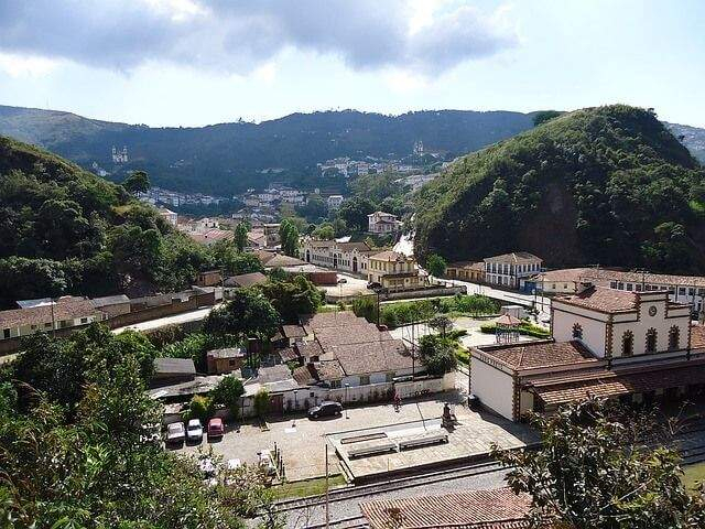 Colonial buildings and lush hills in the town of Ouro Preto in Minas Gerais, Brazil