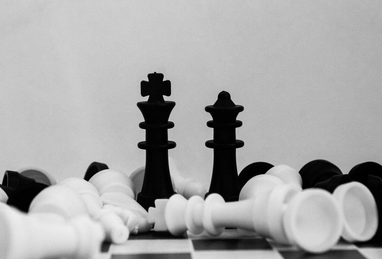 A black-and-white photo of part of a chess set.