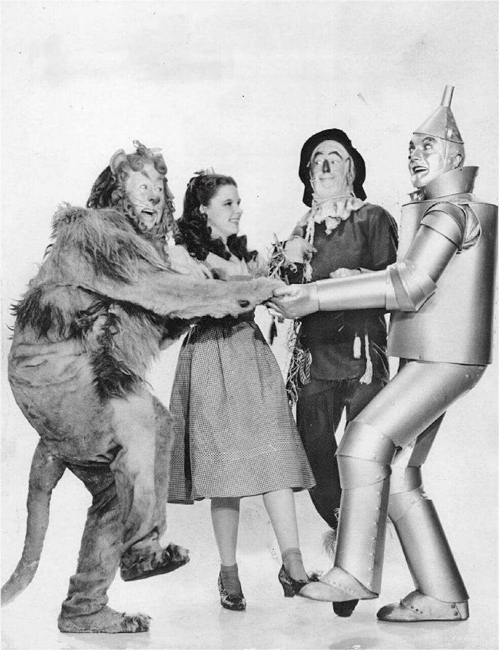 A black-and-white photo of the four main characters from The Wizard of Oz.