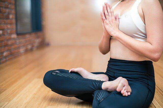 A woman sitting in a yoga pose